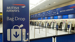 """File photo dated 27/05/17 of an empty British Airways check-in desk at Gatwick Airport. A """"significant number of customers"""" are still without their luggage after a British Airways IT failure that caused global flight disruption."""