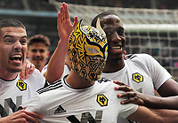 Football - 2018 / 2019 Emirates FA Cup - Semi-Final: Wolverhampton Wanderers vs. Watford<br /> <br /> Raul of Wolves celebrates scoring goal no 2 by putting on  a Wolves mask over his head , at Wembley Stadium.<br /> Team mates Conor Coady (left) and Willy Boly (right)<br /> <br /> COLORSPORT/ANDREW COWIE