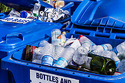 Recycling bins with plastic, glass and aluminum containers.