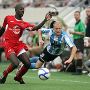 Orlando City Lions Midfielder Lawrence Olum (13) defends against Luke Mulholland (8) during a United Soccer League Pro soccer match between the Wilmington Hammerheads and the Orlando City Lions at the Florida Citrus Bowl on June 18, 2011 in Orlando, Florida.  (AP Photo/Alex Menendez)