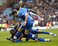 Photo: Richard Lane.<br /> Aston Villa v Birmingham City. Barclaycard Premiership. 22/02/2004.<br /> Stern John celebrates scoring Birmingham's late equliser with Olivier Tebily and Damien Johnson.