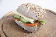 Single Cheese sandwich on a wooden platter