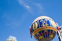 Airplane flys over Las Vegas Boulevard, Las Vegas, Nevada. Also known as The Las Vegas Strip where many of the famous themed casinos and hotels are located.