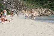 Kirsten Dunst.<br /> Kirsten Dunst body surfing and playing with her girlfriends on the beach.<br /> December 29, 2004.<br /> St. Barth, Caribbean.<br /> Photo by Celebrityvibe.com