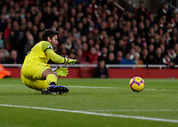 Football - 2018 / 2019 Premier League - Arsenal vs. Liverpool<br /> <br /> (Arsenal FC) gets down low to save at The Emirates.<br /> <br /> COLORSPORT/DANIEL BEARHAM