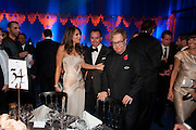 ELIZABETH HURLEY; DAVID FURNISH; SIR ELTON JOHN, Grey Goose character and cocktails. The Elton John Aids Foundation Winter Ball. off Nine Elms Lane. London SW8. 30 October 2010. -DO NOT ARCHIVE-© Copyright Photograph by Dafydd Jones. 248 Clapham Rd. London SW9 0PZ. Tel 0207 820 0771. www.dafjones.com.