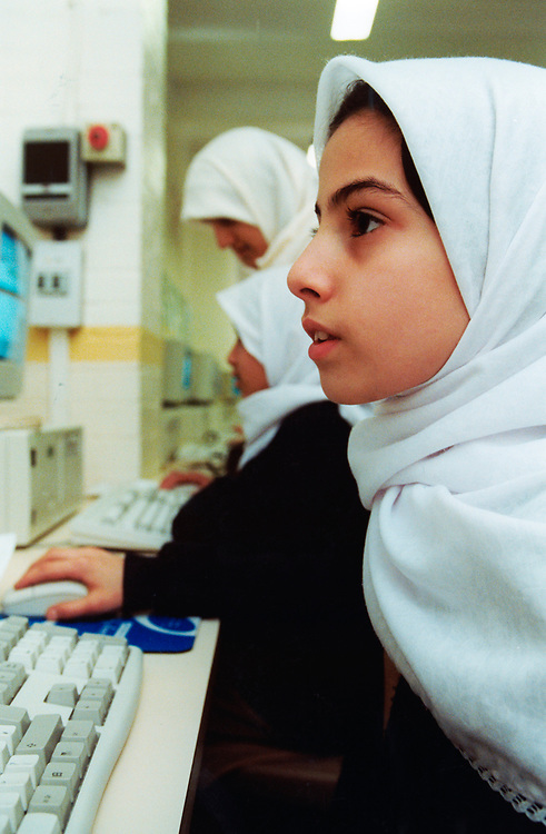 Islamia School for Muslim children - girl working at computer, UK