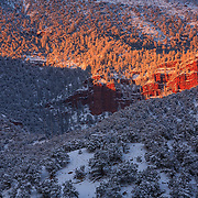 A clearing winter storm colors Bellyache Ridge in alpenglow at sunset in Eagle Colorado.