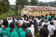 Andrew Kaggwa the community nurse from Bwindi Community Hospital leads a health education and nutrition training session with classes P 3,4,5,6,7 at Nyamiyaga primary school. As part of the outreach programme they cover 32 primary schools and 5 secondary schools in the region as well as many communities. The main Bwindi Community Hospital is in Buhoma village on the edge of the Bwindi Impenetrable Forest in Western Uganda. It serves around 60,000 people from the surrounding area.
