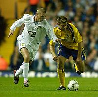 Photo. Jed Wee<br /> Leeds United v Southampton, FA Barclaycard Premiership, Elland Road, Leeds. 26/08/2003.<br /> Leeds' Seth Johnson (L) gets the better of Southampton's James Beattie.