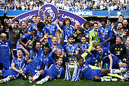 Chelsea FC players celebrate with the trophy during the Premier League match between Chelsea and Sunderland at Stamford Bridge, London, England on 21 May 2017. Photo by Andy Walter.