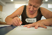 08/09/2015 - Lisbon, Portugal: Maria Manuela Graça, 59, cuts her stencil before going to paint a wall during the Lata 65 workshop. Lata 65 was project created by Lara Seixo Rodrigues and is a creative workshop teaching street art to senior citizens. (Eduardo Leal)