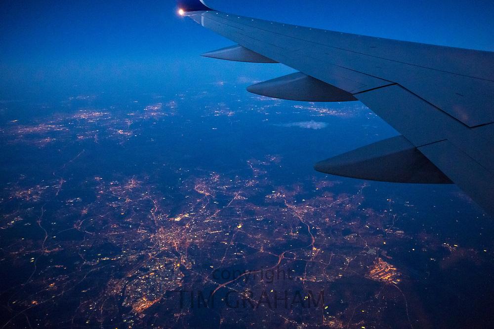 Generic image of aeroplane in flight, twilight evening flight over the United Kingdom