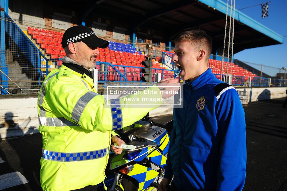 Fife Division, Roads Policing Festive launch, Central Park, Cowdenbeath, 29-11-2019<br /> <br /> Cowdenbeath player Kyle Sneddon gets a drug swipe from PC Seb Milne<br /> <br /> (c) David Wardle | Edinburgh Elite media