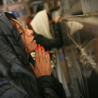 A Jewish woman prays at the grave of Yonatan ben Uziel at Amukah in the Galilee in Israel. Over the centuries the tradition developed that those seeking for their soul-mates would be married within one year if they prayed at Rabbi Ben-Uziel's tomb.
