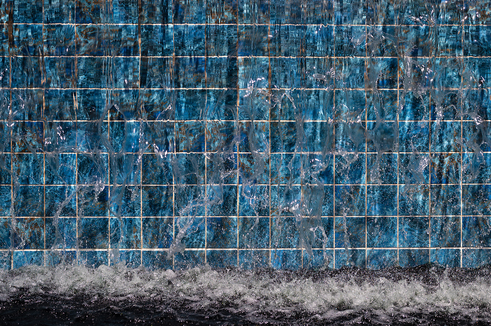 Water cascades over tiles on a water feature at the Denver Botanic Gardens in Colorado.