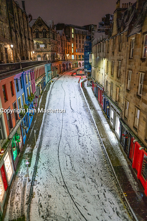 Edinburgh, Scotland, UK. 21 January 2020. Scenes taken between 4am and 5am in Edinburgh city centre after overnight snow fall. `Victoria Street in Old Town at night. Iain Masterton/Alamy Live News