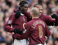 Photo: Lee Earle.<br /> Fulham v Arsenal. The Barclays Premiership. 04/03/2006. Arsenal's Emmanuel Eboue (L) is congratulated by Freddie Ljungberg (C) and Thierry Henry after scoring their second.