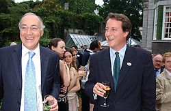 Left to right, MICHAEL HOWARD MP and DAVID CAMERON MP at the No Campaign's Summer Party - a celebration of the 'Non' and 'Nee' votes in the Europen referendum in France and The Netherlands held at The Peacock House, 8 Addison Road, London W14 on 5th July 2005.<br /><br />NON EXCLUSIVE - WORLD RIGHTS