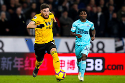 Matt Doherty of Wolverhampton Wanderers goes past Christian Atsu of Newcastle United - Mandatory by-line: Robbie Stephenson/JMP - 11/02/2019 - FOOTBALL - Molineux - Wolverhampton, England - Wolverhampton Wanderers v Newcastle United - Premier League