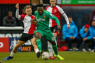 Watford forward Isaac Success (10) tackled by Woking defender Josh Casey (3) during the The FA Cup 3rd round match between Woking and Watford at the Kingfield Stadium, Woking, United Kingdom on 6 January 2019.