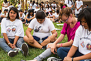 23 APRIL 2012 - PHOENIX, AZ:    High School students pray on the lawn after their arrival at the Arizona State Capitol in Phoenix Monday. About 200 high school students from across the Phoenix metropolitan area rallied at the Arizona state capitol in Phoenix Monday to show their opposition to Arizona's tough anti-immigration law, SB 1070. April 23 is the 2nd anniversary of the law's signing. The US Supreme Court is taking up the law during a hearing Wednesday, April 25 in Washington DC.     PHOTO BY JACK KURTZ