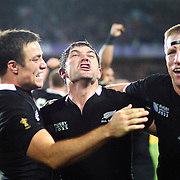 Richard Kahui, (left), Stephen Donald, (centre) and Brad Thorn, New Zealand, celebrate victory at the final whistle during his sides 8-7 victory over France in the Final of the IRB Rugby World Cup tournament, Eden Park, Auckland, New Zealand. 23rd October 2011. Photo Tim Clayton...