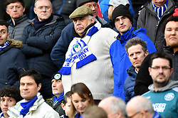A Wigan Athletic fan in the stands shows his support