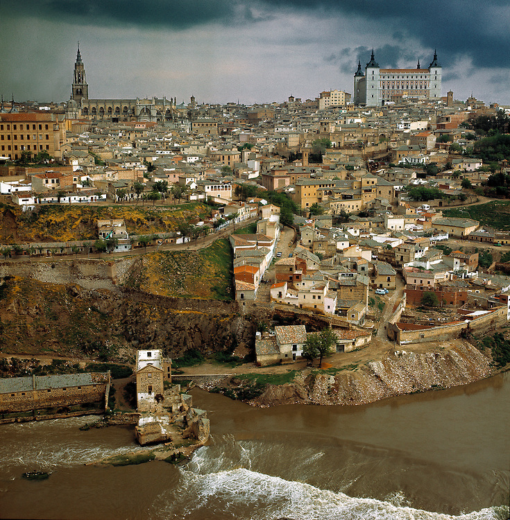 The city of Toledo, with its grand cathedral, rises above the Tagus River in central Spain.