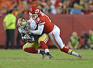KANSAS CITY, MO - AUGUST 16:  Punter Dustin Colquitt #2 of the Kansas City Chiefs tackles linebacker Parys Haralson #98 of the San Francisco 49ers, after Haralson blocked Colquitt's punt during the second half on August 16, 2013 at Arrowhead Stadium in Kansas City, Missouri.  The 49ers won 15-13. (Photo by Peter Aiken/Getty Images) *** Local Caption *** Dustin Colquitt;Parys Haralson