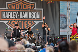 The Harley-Davidson stage at the Full Moon Saloon on Main Street during Daytona Bike Week's 75th Anniversary event. FL, USA. Saturday March 12, 2016.  Photography ©2016 Michael Lichter.