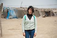 Lima, Peru. Jicamarca. Teresa Sedano Unocc in front of her home