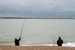 © Licensed to London News Pictures. 06/04/2014. Felixstowe, UK. Fishermen cast their lines. People under cloudy and windy conditions on the shoreline at Felixstowe today 6th April 2014. Photo credit : Stephen Simpson/LNP