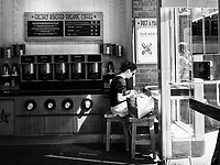 Young woman using her cellphone in a Pret A Manger restaurant in Midtown, New York City.