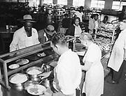 Y-480604-02.  Flood evacuees at Swan Island. Red Cross serving dinner to Black evacuees at cafeteria line. June 4, 1948