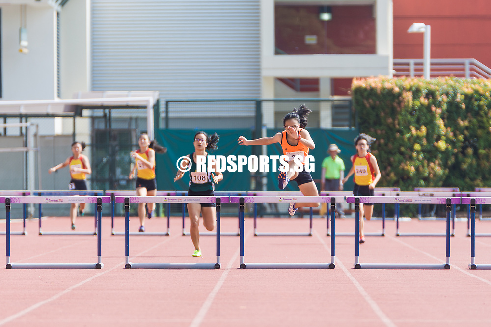 Celeste Goh (#39) of Singapore Sports School jumps over the last hurdle, she finished first with a timing of 1:05.35, setting a new record for the A Division girls' 400 metres hurdles. (Photo © Jerald Ang/Red Sports)