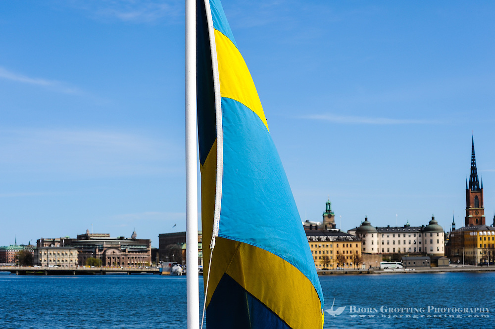 Sweden, Stockholm. Flag on passenger boat, Lake Mälaren.