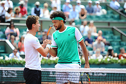 Renzo Olivo of Argentina and Jo-Wilfried Tsonga of France during the first round match on day four of the 2017 French Open at Roland Garros on May 31, 2017 in Paris, France. Jo-Wilfried Tsonga lost during his first round. Photo by Henri Szwarc/ABACAPRESS.COM