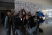 April 2, 2016; Indianapolis, Ind.; Members of the UAA women's basketball team point to the Seawolves' logo after their green screen session at the NCAA Headquarters.