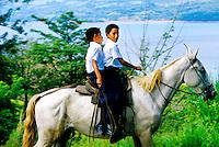 Boys riding their horse to school, near Lake Arenal (Laguna de Arenal), Costa Rica