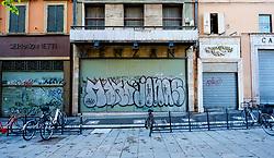 Shuttered up closed shop with graphiti, Bologna, Italy<br /> <br /> (c) Andrew Wilson | Edinburgh Elite media