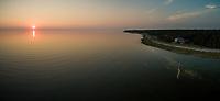 Aerial view of Vormsi island coastline  at sunset in Estonia.