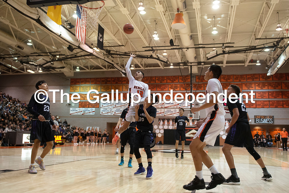 Gallup Bengal Isaac Bustinza (12) drives to the basket during their 1-4A semi-final tournament game against the Miyamura Patriots Wednesday night at Gallup High School. Gallup took the win 72-39.