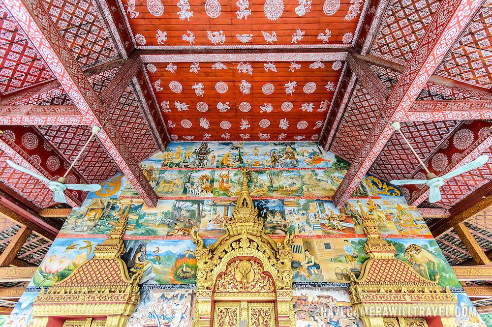 The painted walls and ceiling at Wat Phonxay Sanasongkham in Luang Prabang, Laos.