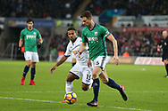 Jonny Evans of West Bromwich Albion goes past Wayne Routledge of Swansea city. Premier league match, Swansea city v West Bromwich Albion at the Liberty Stadium in Swansea, South Wales on Saturday 9th December 2017.<br /> pic by  Andrew Orchard, Andrew Orchard sports photography.