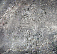 Prehistoric Petroglyph, rock carving, of what is known as the Map of Bebolina with depictions of huts raised on wooden poles and field systems carved by the Camunni people in the iron age between 1000-1600 BC, Bedolina Rock no 1 , Seradina-Bedolina Archaeological Park, Valle Comenica, Lombardy, Italy .<br /> <br /> Visit our PREHISTORY PHOTO COLLECTIONS for more   photos  to download or buy as prints https://funkystock.photoshelter.com/gallery-collection/Prehistoric-Neolithic-Sites-Art-Artefacts-Pictures-Photos/C0000tfxw63zrUT4<br /> If you prefer to buy from our ALAMY PHOTO LIBRARY  Collection visit : https://www.alamy.com/portfolio/paul-williams-funkystock/valcamonica-rock-art.html