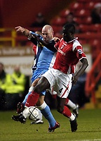 Photo: Olly Greenwood.<br />Charlton Athletic v Wycombe Wanderers. Carling Cup. 19/12/2006. Wycombe's Tommy Mooney and Charlton's Amady Faye