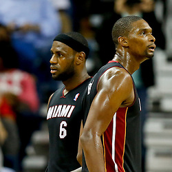 Oct 23, 2013; New Orleans, LA, USA; Miami Heat power forward Chris Bosh (1) and small forward LeBron James (6) against the New Orleans Pelicans during the second half of a preseason game at New Orleans Arena. The Heat defeated the Pelicans 108-95. Mandatory Credit: Derick E. Hingle-USA TODAY Sports
