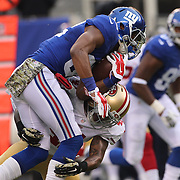 Rueben Randle, New York Giants, is tackled during the New York Giants V San Francisco 49ers, NFL American Football match at MetLife Stadium, East Rutherford, NJ, USA. 16th November 2014. Photo Tim Clayton