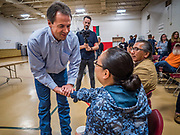 17 MAY 2019 - MESKWAKI, IOWA: Governor STEVE BULLOCK (D-MT) talks to an Iowa voter at the Meskwaki settlement, a Native American community in Iowa. Gov. Bullock joined a crowded field of Democrats vying to be the party's Presidential nominee in 2020. Iowa traditionally hosts the the first election event of the presidential election cycle. The Iowa Caucuses will be on Feb. 3, 2020.                      PHOTO BY JACK KURTZ